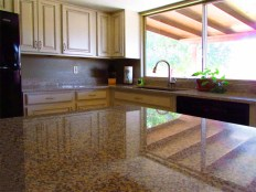 kitchen window and patio roof reflected on shiny granite kitchen countertop - 783 W Park Ave, Chandler Arizona - Granite Countertops - Bill Salvatore, Arizona Elite Properties 602-999-0952 - Arizona Real Estate