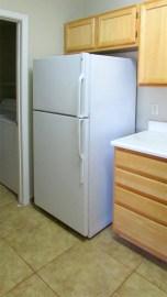 refrigerator (included) next to laundry room door off kitchen - Red Rox Condominiums - 5401 E Van Buren St, Phoenix AZ - Unit #3002 - appliances included, range, microwave, dishwasher, refrigerator, washer and dryer - Bill Salvatore, Arizona Elite Properties 602-999-0952 - Arizona Real Estate