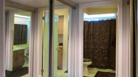 Double closets with mirrored sliding doors on either side of hallway into master bath 1 - 945 N Pasadena, Mesa AZ - Park Centre Patio Homes - Bill Salvatore, Arizona Elite Properties 602-999-0952 - Arizona Real Estate