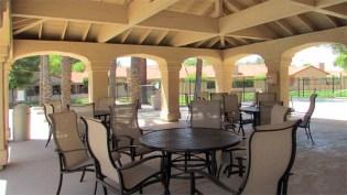 Archways surrounding several round tables and patio chairs in poolside ramada - 945 N Pasadena, Mesa AZ - Park Centre Patio Homes - Bill Salvatore, Arizona Elite Properties 602-999-0952 - Arizona Real Estate