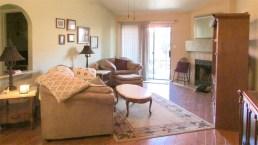 Living room with fireplace and wood laminate floor, slider entry to back patio - 945 N Pasadena, Mesa AZ - Park Centre Patio Homes - Bill Salvatore, Arizona Elite Properties 602-999-0952 - Arizona Real Estate