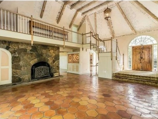 Great room with stone fireplace, stone tile flooring, wood beams and stenciled, whitewashed ceiling and walls - (photo: RIS Media) - Cyndi Lauper's Stamford CT home for sale - Bill Salvatore, Arizona Elite Properties 602-999-0952 - Arizona Real Estate