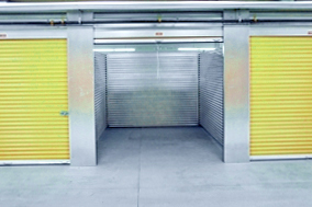 self storage units with yellow doors, one door open - self storage, stoage unit, organization, organizing storage - Bill Salvatore, Arizona Elite Properties 602-999-0952 - Arizona Real Estate
