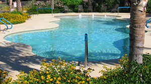 large, sparkling blue swimming pool with fountains, surrounded by cool decking - swimming pool, luxury pool, home improvement, expensive remodeling - Bill Salvatore, Arizona Elite Properties 602-999-0952 - Arizona Real Estate