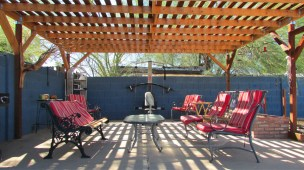 patio furniture and exercise equipment on large pergola covered patio - Great cement patio - Large Lot - 161 N 88th Place, Mesa AZ - Bill Salvatore, Arizona Elite Properties - Mesa Arizona property for sale