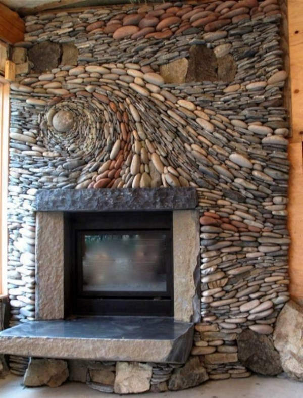 fireplace with river rock in a swirl pattern, and solid blustone mantle - Contemporary fireplaces, homes for sale with a fireplace - Bill Salvatore, Arizona Elite Properties 602-999-0952 - Arizona Homes for Sale