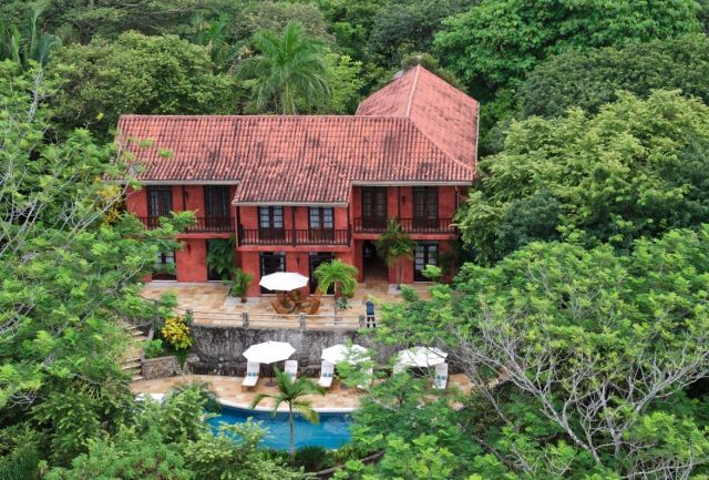 aerial view of l-shaped home, brick exterior, swimming pools and terraced patio - Great Room - Mel Gibson's Costa Rica house for sale, Costa Rica Vacation property, Luxury home on Costa Rica - Bill Salvatore, Arizona Elite Properties 602-999-0952 - Arizona Real Estate