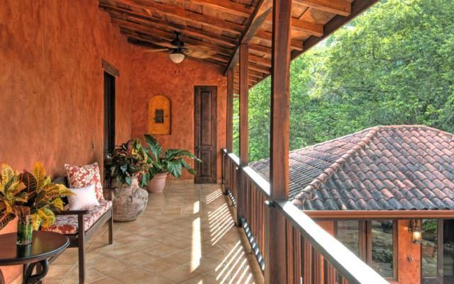 Second floor exterior balcony with potted plants and comfortable furniture - Exterior balcony - Mel Gibson's Costa Rica house for sale, Costa Rica Vacation property, Luxury home on Costa Rica - Bill Salvatore, Arizona Elite Properties 602-999-0952 - Costa Rica Real Estate for Sale