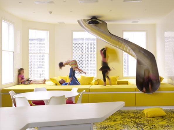 kids playing in a bright yellow room with sliver indoor slide from floor above - unique home features - indoor slide 2 Source: RIS Media - Bill Salvatore, Arizona Elite Properties 602-999-0952 - Arizona Real Estate
