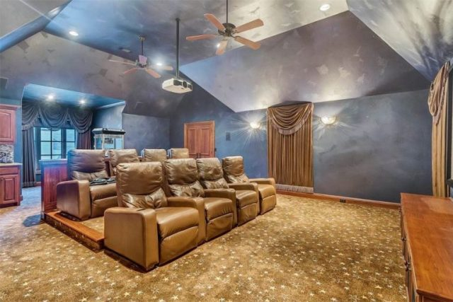 large blue theater room with plush carpeting and two rows of reclining seats - Theater Room - Selena Gomez's Fort Worth Texas Home for Sale - Bill Salvatore, Arizona Elite Properties 602-999-0952 - Arizona Real Estate