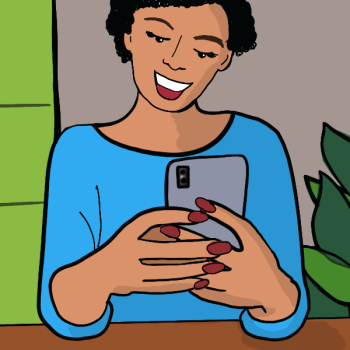 Woman holding phone looking at instagram