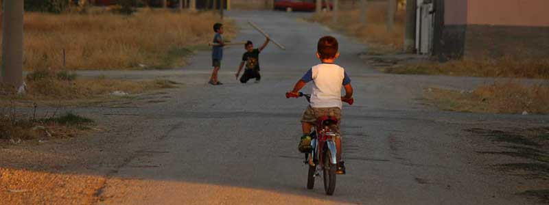 Street children playing on a bike