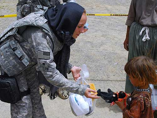 kindness soldier giving toy child