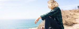 thinking woman sea ocean beach sitting
