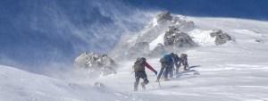mountain climbing crew snow difficult