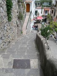 Steps leading down to restaurants in Positano