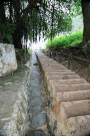 Steps leading down to the Praia de Cachorro.