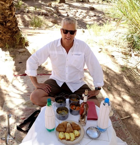 Dar Ahlam picnic in an oasis. table