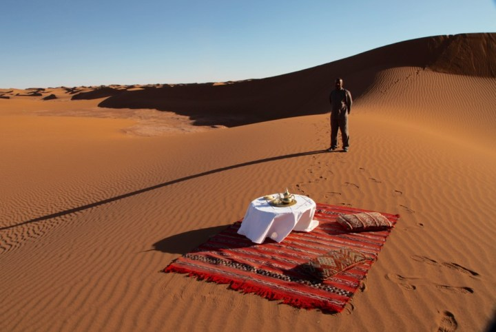 Dar Ahlam Tent Camp table and rug