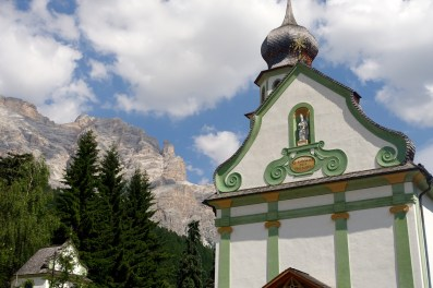 San Cassiano church and mountains
