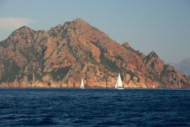 Scandola Nature Preserve sailboats in distance