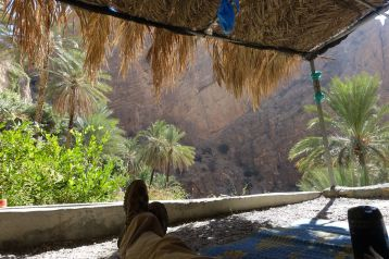 After a long hour and a half hike down, we chilled in the shade next to the falaj, where Salim poured me some hot Arabic coffee and we split a bag of Omani dates. I may have eaten too many. Salim says, like in most of Oman, anyone can stay the night here, even though it is someone else's land. Omani culture allows people to camp anywhere. The showed some woven mates made from date palms that we sat on in the cool shade.