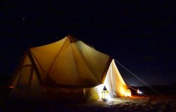 Canvas Club tent at night