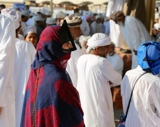 The indigo masks are striking and go back thousands of years, when the indigo dye color was one of the most expensive in the worlds. These are totally distinctive from the abayas I've seen elsewhere. And totally alluring. I watched this beautiful women with the finest fabrics participate in the bidding, go up and ask questions about a particular sheep, etc. She seemed to rule her house.