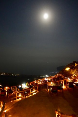 One of the most special nights at Zighy Bay is their super cool restaurant on top of the mountain called Sense on the Edge, a couple thousand feet above the bay --- perched on the edge of a steep cliff... right next to where you launch for the paragliding. The views are unreal, as is the food. As my dumb luck would have it, I was there during this week's amazing full moon.