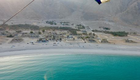 This is the neighbors -- the village of Zaghi. Never really saw many of the local people in the water or on the beaches.