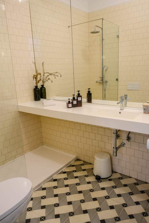 The bathrooms were awesome, with cool Portuguese tile. Their own bulk bottles of shampoo and conditioner, ready when you are.