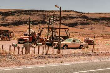 Even dusty old Oldsmobiles and American gas pumps.