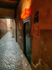 You zigzag through the alleys as they get narrower and narrower and quieter. Then you see the subtle door.