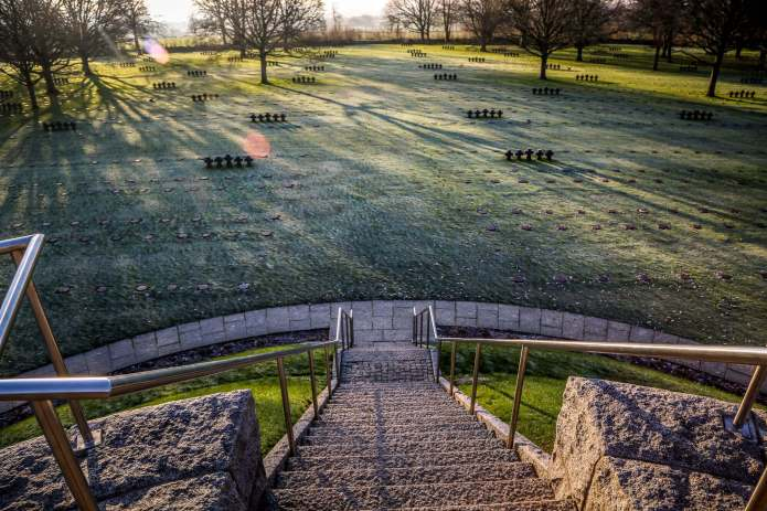 German Cemetery Normandy monument stairs sunrise