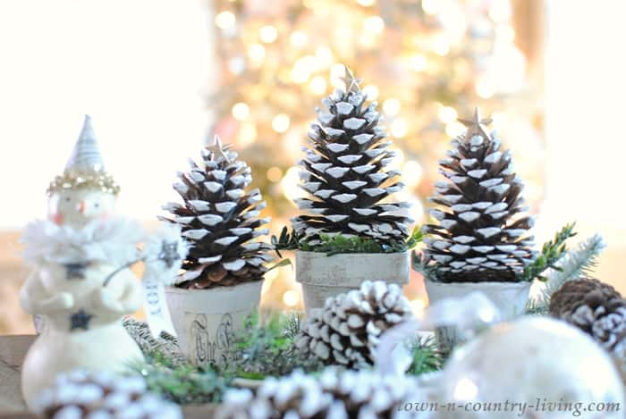 Pinecone Christmas trees centerpiece on table
