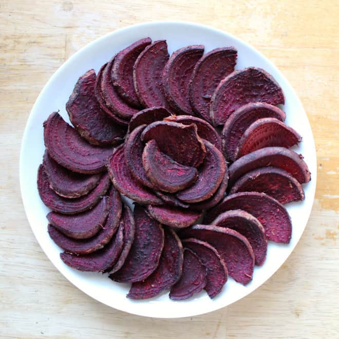 BBQ beet fries arranged in spiral on white plate