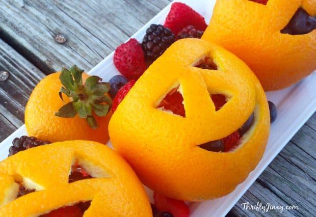 Halloween fruit ideas: orange jack-o-lantern fruit salad