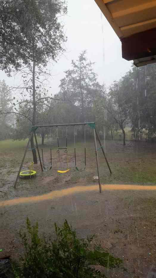 Heavy rain causing flooding in the yard.