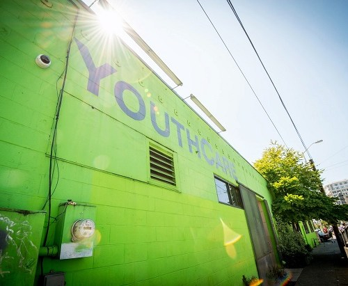 Picture of green building with YouthCare written on top