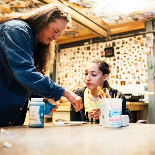 Tile Project - Instructor helping youth at craft table