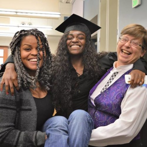 youthbuild graduate and staff