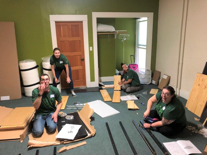 Volunteers building furniture