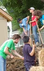 Youth farmers turn the compost.