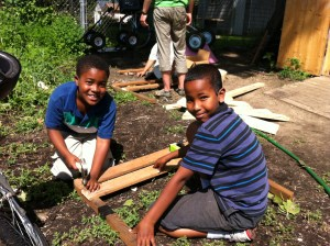 Youth farmers work on a project at the main farm in Frogtown.