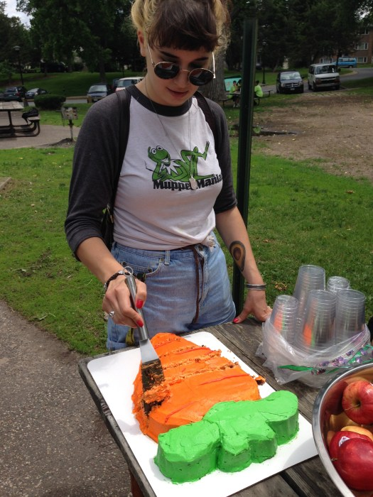 West Side Project LEAD Nora slicing up a special Youth Farm cake decorated by her sister, Farm Steward Alice Martin.
