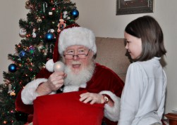 Santa does magic. The light bulb only stays on for him.