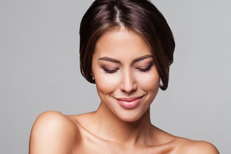 woman with brown hair and professional makeup, smilingBelotero