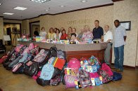 Backpack Heroes - Crye-Leike volunteers help stuff backpacks with supplies