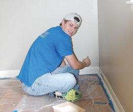 HCA volunteers repaint the entire interior of the Binkley Group Home
