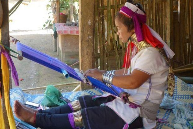 One of the women who sews in a traditional manner